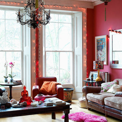 boho chic living room with red walls